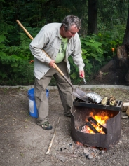 Ken demonstrates proper use of cooking utensils including a shovel and pliers