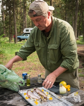 Getting the trout ready to cook in the campfire