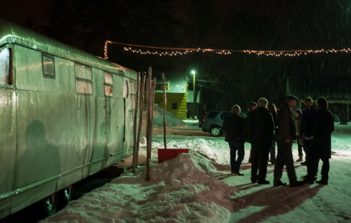 After the performance, visiting with the musicians as snow falls.