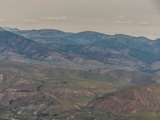 The reddish colored forests and hills in the background burned last summer.