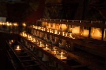 Only smokeless candles sold in the Mission's store can be used in the church. Generations of smoky candles have left their mark on the walls.