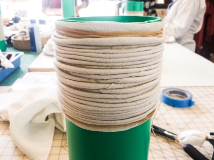 The fabric was wound around the pipe and then covered with string before dying