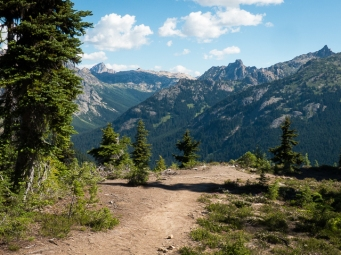 The trail climbs steeply and the views unfold in a grand way