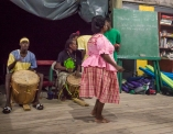 Miss Anne demonstrates a traditional dance