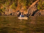 Trying to catch a salmon from a kayak. What if he caught one?