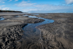 Low tide reveals channels in the sand