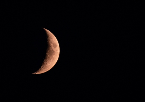 Reddish crescent moon