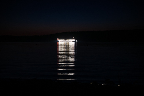 A ferry at night