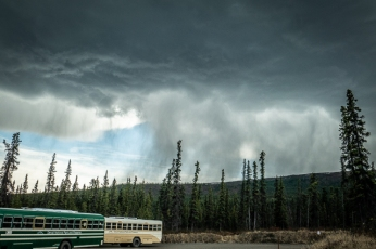 Park buses and an approaching thunder storm